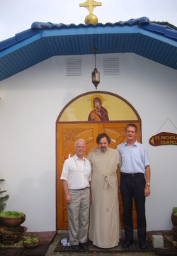 The Representative of the Russian Orthodox Church in Thailand archimandrite Oleg (Cherepanin) - in the center, Jukka Helle, head of the Finnish Lutheran Mission in Bangkok (right), Brother Ghislain - a member of the ecumenical community in Taize (France), - on the left, near the Chapel of St. Nicholas the Wonderworker, archbishop of Myra in Lycia.
