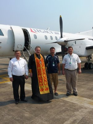 Archimadrite Oleg (Cherepanin with Legacy Air executives at U-Tapao Airport)