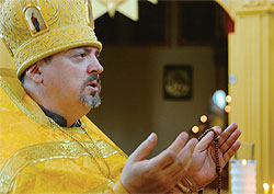 LEADING THE WAY: Archimandrite Oleg in his church in Pattaya.